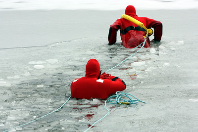 You can see the ice cracking in front of the first emergency responder as he attempts to once again lift himself out of the frigid water.