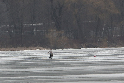 The second fisherman still heading away from the emergency team. Emergency responders from the Netcong shoreline are heading onto the lake to rescue this man.