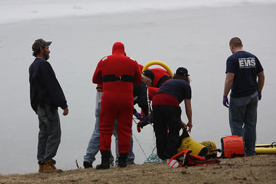 The two emergency workers were tethered to life line and entered the waters one at a time. The shore line ice was thin and unable to support the weight of the men and they immediately plunged into the frigid water.