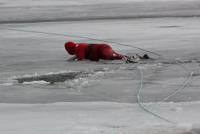 Again the ice breaks. The second rescuer gets back onto the surface.