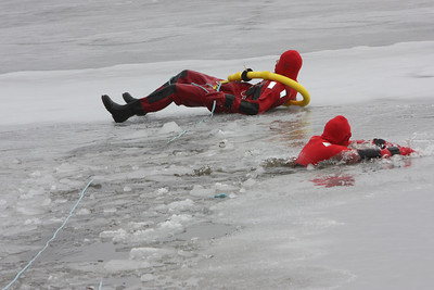 The first responder on the emergency team makes it out of the water about 25 ft from the shore line.