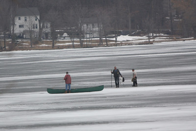 Two men ice fishing on Lake Musconetcong fell through the ice. The temperature reached 60 degrees today. A good samaritan (on the left) saw the commotion out on the ice and brought his canoe out to rescue the two men. Emergency personnel had to be called to rescue all three men from the ice.