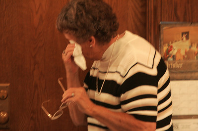 4OCT09   Organist Tina Leonard wipes away tears after her  last mass at Lorain's Ss Cyril & Methodius.        photo by Chuck Humel