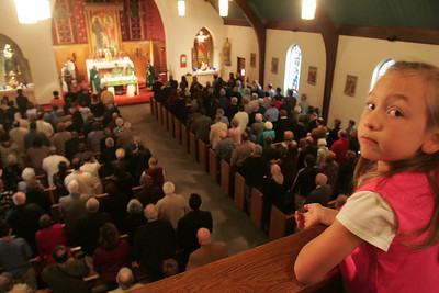 4OCT09  Six-year-old Veronica Janosik of Amherst Twp. watches the last mass at Lorain's Ss Cyril & Methodius.        photo by Chuck Humel