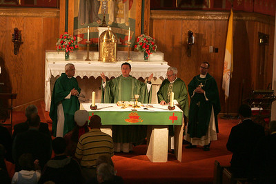4OCT09   Main Celebrant Rev. Lawrence Jurcak, second from left, leads the last mass at Lorain's Ss Cyril & Methodius.  Rev. Joseph Yelenc is far left, Rev. Paul Krjnik, is third from left, and Rev. Charles Strebler is far right.      photo by Chuck Humel