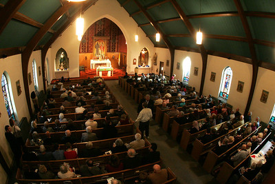 4OCT09   Worshippers arrive early for the last mass at Saints Cyril & Methodius Catholic Church in Lorain; over two hundred worshippers crowded into the edifice.   photo by Chuck Humel