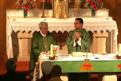 4OCT09   Main Celebrant Rev. Lawrence Jurcak, right,  asked the congregation to stand and applaud the dedication that the Rev. Paul Krajnik, left, has given for the past 34 years.  Sunday was the last mass at Saints Cyril & Methodius Catholic Church in Lorain.   photo by Chuck Humel