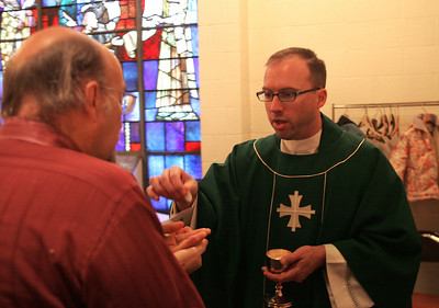 4OCT09   The Rev. Charles Strebler offers Eucharist in the balcony at the last mass at Lorain's Ss Cyril & Methodius.        photo by Chuck Humel