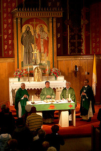 4OCT09   Main Celebrant Rev. Lawrence Jurcak, the Dioces Secretary for Clergy and Religious, second from left, leads the last mass at Lorain's Ss Cyril & Methodius.  Rev. Joseph Yelenc is far left, Rev. Paul Krjnik, is third from left, and Rev. Charles Strebler is far right.      photo by Chuck Humel