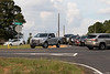 September 13, 2018-Fayetteville, GA<br /> <br /> More video and photos from GA Highway 92 and Veterans Parkway. <br /> <br /> A frustrated driver is nearly hit by southbound traffic.<br /> <br /> The memorial is about 50 yards north of the recently opened Veterans Parkway where Westbridge Road ended before being re-aligned with Veterans Parkway.<br />  I timed the wait times for several cars at over 6 minutes