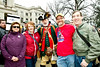 Feb 8, 2013-Atlanta, GA-Second Amendment Rally at the Georgia State Capitol-Supporters of the 2nd Amendment were out on the steps of the Gold Dome on Friday morning to rally support. <br /> <br /> There were about 250 supporters along Washington Street showing that the majority of gun owners are law abiding citizens.<br /> <br /> Gun restriction supporters staged a smaller counter-protest across the street.<br /> <br /> From left to right, Peachtree City, GA, residents, Susan Primrose, Jane Trammell, Brian Graffius and Sean Laughlin pose for a photo with William Temple - Viet Nam Veteran, Tea Partier dressed in Patriot Garb