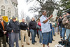 Feb 8, 2013-Atlanta, GA-Second Amendment Rally at the Georgia State Capitol-Supporters of the 2nd Amendment were out on the steps of the Gold Dome on Friday morning to rally support. <br /> <br /> There were about 250 supporters along Washington Street showing that the majority of gun owners are law abiding citizens.<br /> <br /> Gun restriction supporters staged a smaller counter-protest across the street.<br /> <br /> <br /> A heckler in the crowd seemed determined to create a stir among the supporters attending the rally. The heckler holds up a newspaper, apparently attempting to block the view of participants at the rally. After creating a minor disturbance, he left without indentifying himself.