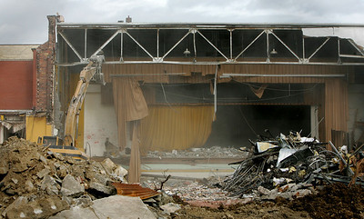 6OCT09  Last Curtain Call at Lorain High School:   An excavator claws at the truss over the stage at the old Lorain High School.  How many parents came to watch plays on the stage during its history.  photo by CHuck Humel