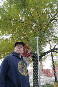 6OCT09  Tom Hoerrle of Lorain graduated from Lorain High School in the mid-1970s and he a handfull of classmates planted the ash tree in the background in the fall of 1975.  Hoerrle is a historian for Sheffield Village Historical Society and has also studied the history of the school.  photo by CHuck Humel