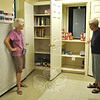 FAITH Food Pantry volunteer Barbara Lynch, left, and FAITH Director Lee Paulson are dismayed by empty shelves at the pantry. Donations are desperately needed to accommodate the more than 120 town families now making use of the free food pantry each week.   (Crevier photo)