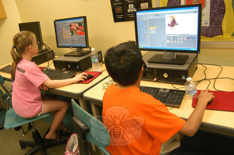 Two students worked on Wednesday, July 11, in this summer's Scratch Programming course overseen by Tim McGuire and provided through Newtown Continuing Education.   (Hallabeck photo)