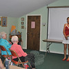 Ann Waldman, right, addresses an audience at the Newtown Senior Center, Tuesday, July 17, about women and heart disease. Ms Waldman is a heart attack survivor.   (Crevier photo)