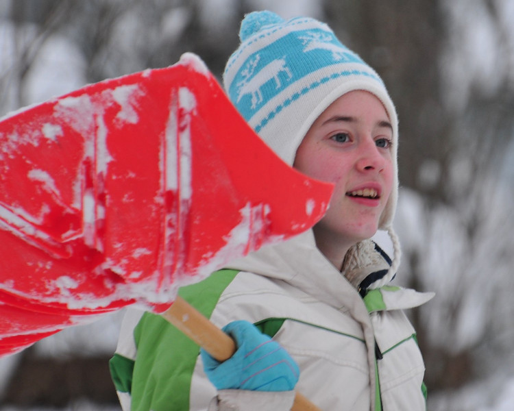 Hard working snow shoveler