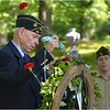 John P. Curran of Walsh American Legion Post 369 adds to wreath in memory of veterans who passed away during the previous year.