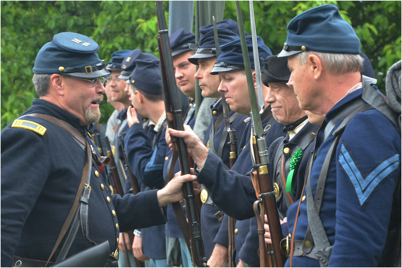 Before the parade, Captain Tom Higgins inspects members of the Massachusetts 28th Regiment Volunteers, a recreation of a unit in the Irish Brigade during the Civil War.