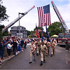 St. Mark's VFW and Amvets unit approaches the main entrance of Cedar Grove Cemetery.