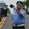 Traffic on Hill Top Street waits as Ernest Abreu of the McKeon Post plays taps on his bugle.