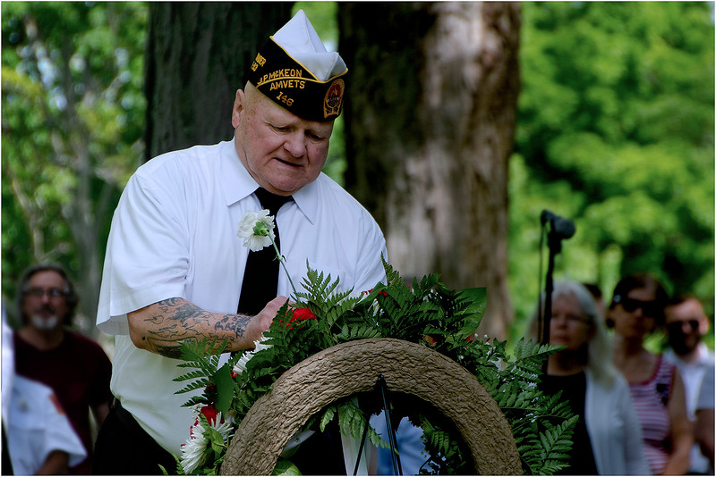 McKeon Post Commander Jack Hussey pays respects to fellow members in a memorial ceremony.