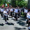 Greater Boston Firefighters Pipes and Drums exit the cemetery after the observance.