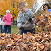 Midview students rake leaves :