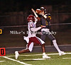 #7 Devonte Curry catches a long pass at the 7 yard line and runs it in for a TD wiith Jaylon Conway defending.