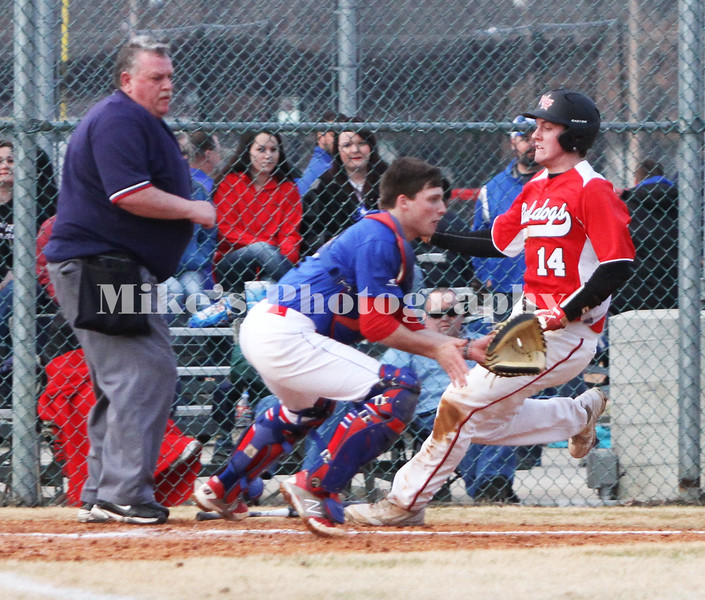 14 Kirk Baugh scores with the catcher 6 Austin White waiting for the ball