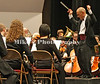 """Maestro Charles Evans Jones conducts the Pine Bluff Symphony Orchestra during the sing a long portion of the concert """"Home for the Holidays: Music of the Season"""" Sunday at the Pine Bluff Convention Center. /Mike Adam"""