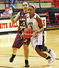 3 Alexis Winston closely guarded by 3 Brandy Scott