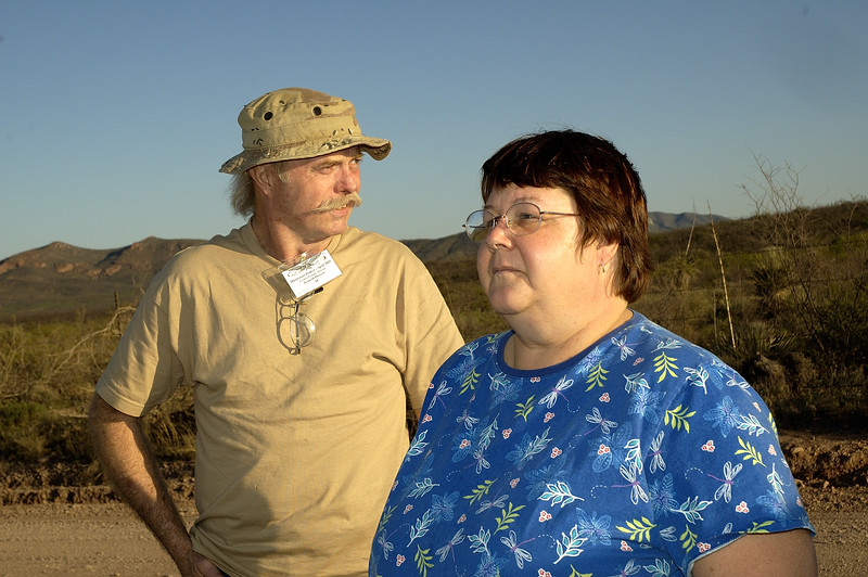 Kenneth and Barbara Davison in front of the Mexican border.