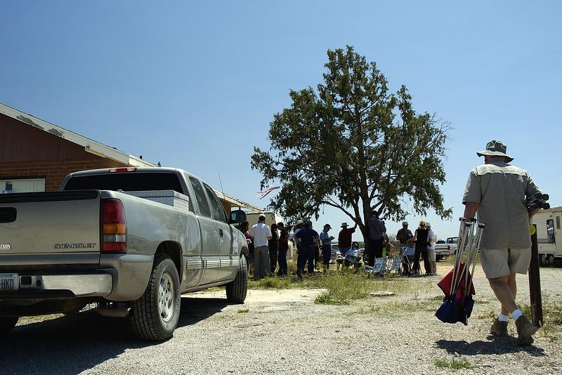 "Palominas, Arizona: briefing for ""Minuteman"" volunteers under a tree."