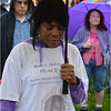 Angel McLean of Dorchester, whose nephew, Donald Averett, was killed in 2002, takes part in a prayer before the start of the walk.