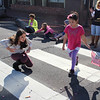 Sky Kennedy, 8, and Raben Kennedy, 11, chase candy being thrown from floats during the parade.