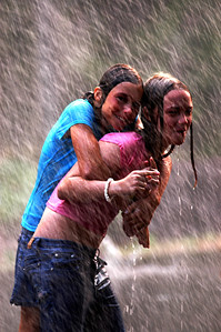 Friends playing in the rain