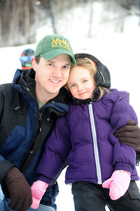 Dad and daugher on the slopes for some fun on snow.