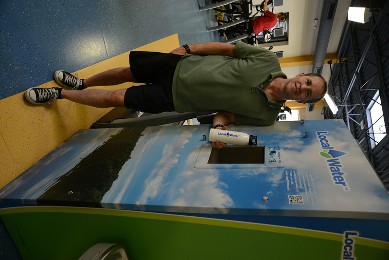 John F. Carney, co-founder of Norwalk-based Local Water, LLC, recently installed a first-of-a-kind water station at Newtown Youth Academy. The system filters and chills local tap water.  (Bobowick photo)