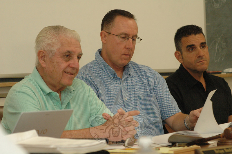 Police Commission members this week discussed the results of a study on low morale among Newtown police officers with the author of the report. From left are Police Commission Chairman Paul Mangiafico and commission members Brian Budd and James Viadero. (Gorosko photo)