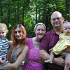From left, Miles, Arielle, Heather, and Roger Eberlin are more than a little pleased to have celebrated baby Rory's first birthday earlier this month. Rory and her cousin, Abigail, in Pennsylvania were both born prematurely, just days apart, last summer. The babies' families were joined by 45 family members and friends in Pennsylvania earlier this month for a first birthday party for the thriving girls. (Crevier photo)