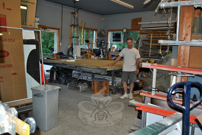 Custom glass work by Apex Glass takes place in the Riverside Road shop in Sandy Hook in a workroom, where a 10- by 12-foot tilt table allows ample space to safely accommodate large pieces. (Crevier photo)