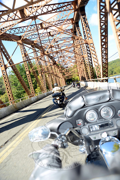 Riders on a bridge over Lake Zoar cross from Southbury into Newtown, and soon make their way along Glen Road into Sandy Hook Center for the third annual Firehouse Ride to benefit Newtown Hook & Ladder Company #1. (Bobowick photo)