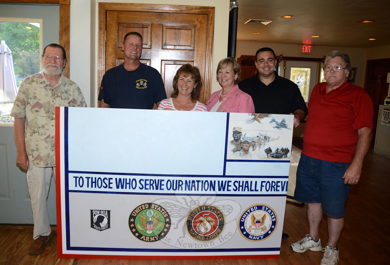 Artist David Merrill stands with some of the Project Newtown Troops and Veterans committee members including, from left, former VFW Commander Dan Kearns, Blue Star mothers Laurie McCollum and Kaki Taylor, and veterans Phil Lombardo and Jay Gill. (Bobowick photo)