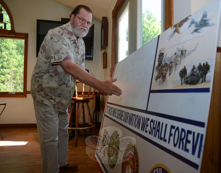 Artist David Merrill recently revealed a piece of a veterans mural he is creating for display at Newtown Municipal Center. He met with Project Newtown Troops and Veterans committee members at the Veterans of Foreign Wars Post 308 on July 30. (Bobowick photo)