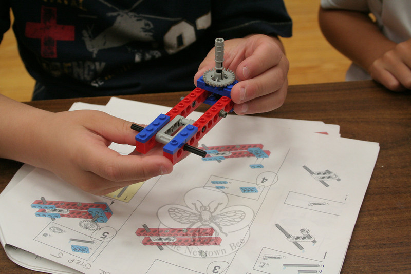 A camper worked to create a Tilt-A-Whirl on Monday, August 6, using a RCX Robotics Lego Carnival kit in the Parks & Recreation Department's Junior Robotics Camp. (Hallabeck photo)