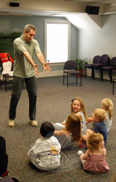 Published children's author and enthusiastic entertainer Jason Edwards put on his Story Play program at C. H. Booth Library Friday, August 3.  (Bonanno photo)