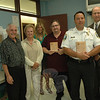 On August 7 at the police station, Yvette Newton, of the state Department of Children and Families (DCF), third from left, presented to police Lieutenant Christopher Vanghele, second from right, and Newtown Bee Associate Editor John Voket, third from right, Community Partner Awards in recognition of the support that they give to DCF, a state agency that provides family services, including foster child and adoption services. Besides his work at The Bee, Mr Voket was recognized for his work as a syndicated broadcaster. Also pictured, from left, are Police Commission Chairman Paul Mangiafico, First Selectman Pat Llodra, and Police Chief Michael Kehoe. (Gorosko photo)