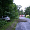 Police report a one-vehicle accident on Toddy Hill Road near its intersection with Surrey Trail at about 8 pm on July 28. Police said motorist Richard Chockey, 44, of Monroe was driving a 2005 GMC Yukon SUV northward on Toddy Hill Road when the vehicle went off the right road shoulder, hit some guardcabling and then struck a utility pole, snapping the pole and causing it to hang over the street. Chockey reported pain and cuts and was treated at the scene by the Newtown Volunteer Ambulance Corps, but refused transport to Danbury Hospital, police said. Botsford firefighters responded to the incident. A section of Toddy Hill road was closed to through-traffic for about three hours while repairs were made. Police said the accident is under investigation.   	     (Hicks photo)